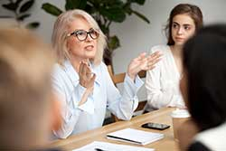 CEO woman at a meeting